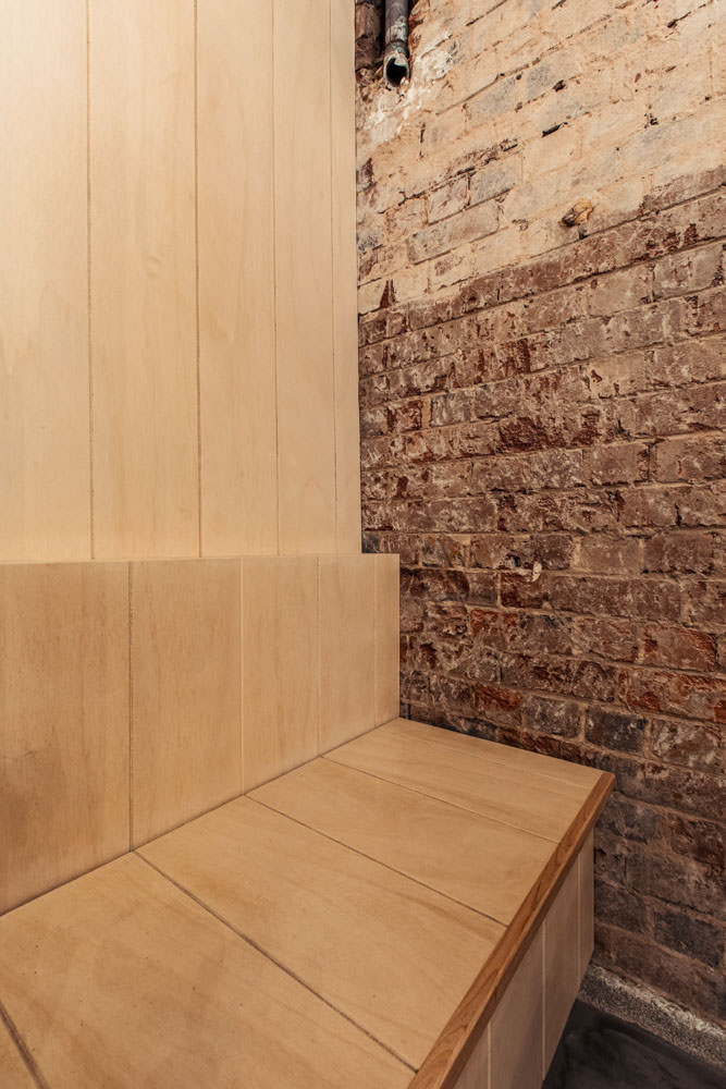 in built banquette seat for bar